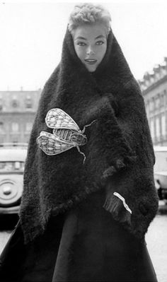 Joan Olson in black boucle shetland stole with oversized insect pin, both by Schiaparelli, Paris, 1952