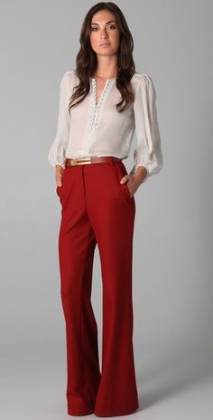 beige blouse, gold belt and red wide trousers