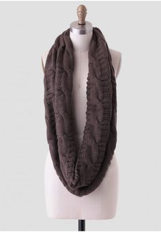 <p>A fall wardrobe staple, this dark olive-hued infinity scarf features a cozy cable knit design perfect for keeping warm during the fall and winter months.</p><p>30% Cotton, 70% Acrylic<br /> Imported<br /> 55