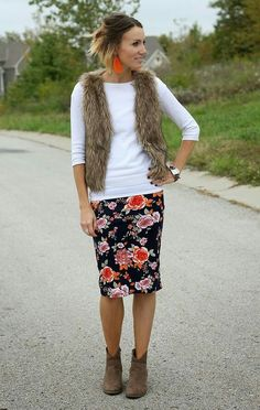 Need something a little bit more professional? A floral pencil skirt looks great with a simple top, ankle boots, and a fur vest for warmth  Read more: http://www.gurl.com/2016/02/13/style-tip-son-how-to-wear-floral-skirts-in-winter-outfit-ideas/#ixzz426LSC7q1