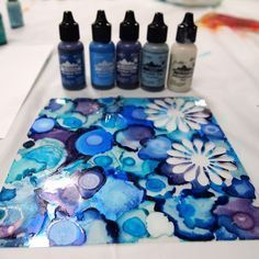 Using alcohol inks on clear plastic with craft punches to make your own translucent embellishments. Stained glass effect for card making project.