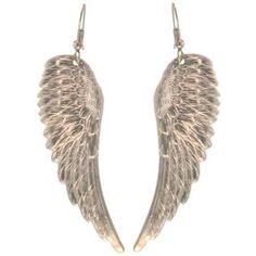 Angel Wing Earrings in Silver Tone. These earrings are handcrafted in our New York workroom of stampings made from vintage toolings. Metal stampings have been used in the jewelry industry since the 1800's. This process can create highly detailed, lightweight, and intricate designs. Because they are stamped out of sheets of metal, stampings like this item commonly have raised detail on the front of the stamping and are hollow on the back.