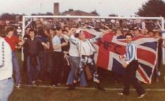 Spurs fans on the pitch at friendly away at Oxford in the 1970s