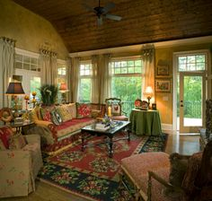 This is such a beautiful room.  It radiates warmth and an invitation to relax.  (Furniture arrangement!)