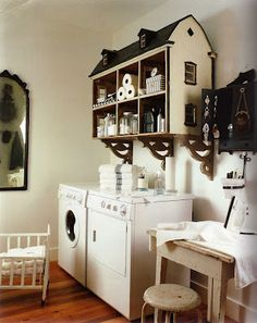 kind of a kooky idea, but... use your old dollhouse as storage. but in craft room.