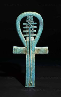 "EGYPT AMULET 2ND-1ST MILL.BCE ~ Faience amulet in the shape of an ankh, 25th dynasty to Late Period, about 700-500 BCE.The ankh (meaning ""life"") is combined with the was-sceptre, the djed pillar,the heh and the hieroglyph for ""millions"". It represents a wish, probably for the king, of ""life,power and stability for millions of years""."