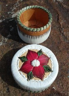 Porcupine quill basket by Cheryl Besito; pink flower.