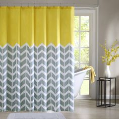 Intelligent Design Elle makes any bathroom fun and inviting. A gray and white chevron print runs along the shower curtain broken up by white vertical stripes. The rich pop of yellow at the top provides a fresh update to your space.