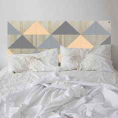 Apricot delight! Lose yourself in the contemporary style of the BERMUDA headboard. It features a series of hand-painted coloured triangles forming a tessellated pattern full of geometric goodness.