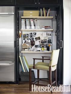 The Perfect Hideaway Office    A desk area utilizing the Container Store's Elfa shelving system is tucked behind doors painted with Sherwin-Williams' chalkboard paint great for reminders.