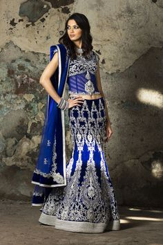 A beautiful royal blue lehenga with sliver detailing.