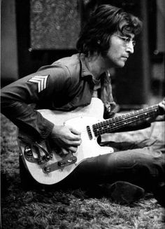 John Lennon and his Fender Telecaster - A Legend at One with Another Legend