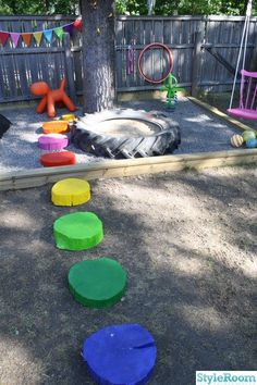 playground painted tree stump wheels! Cute idea since my hubby cuts trees!