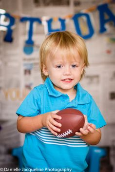 Baby Boy Photos, Photo Shoot Idea, DIY, football, second birthday photo ideas, toddler, terrible 2's, baby photography, Danielle Jacqueline Photography, Blue Quicksilver Shirt, Boy Birthday Banner, baby boy photography props