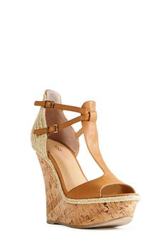 Inspired by the elements of summer, Andie by JustFab gets a breezy bohemian update with a real cork wrap and jute detailing