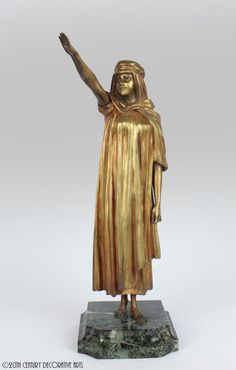 """L'Adieu"" a rare Art Deco gilded and cold-painted ""Orientalist"" bronze sculpture by Demetre Chiparus, France circa 1920's- the young arab woman waving goodbye mounted on a green marble base- 35cm high"