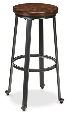 """Add an industrial look to your home with the Challiman 30"""" bar stool. A fusion of forged steel and planked pine, this stool looks equally comfortable in a modern dining room as it does out in the workshop. This base is built using bar-shaped tubular metal with serif notes at the extremities. Up top, the pine veneers that grace the seat have been purposely distressed in a cross saw pattern to lend this piece the classic look of reclaimed lumber."""