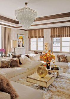 Luxe Life. Look how cozy and rich this apartment room looks. I want I want. Also, the chandelier.