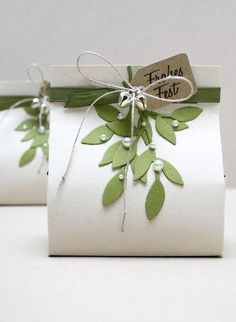 love this packing! Looks like mistletoe! Floral gift bag - for the holidays or a wedding