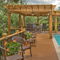 Designed and built by Archadeck of Austin, this L-shaped wood pergola provides shade from the hot Texas sun. Instead of a simple pergola, the owners wanted a structure with weight and detail as you can see in the columns and at the top. Lights and fans were installed on the columns and beams to increase the time that the space can be used.
