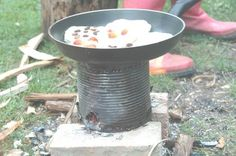 how to make a homemade camping stove (often called a hobo stove) out of a large tin can.    We had to do this years AGO when the power went out due to an ice storm.