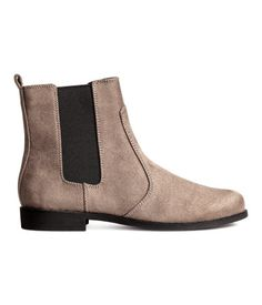 Taupe. Chelsea ankle boots with elastic panels at sides and a loop at back. Cotton twill lining, imitation leather insoles, and rubber soles. Heel height 1