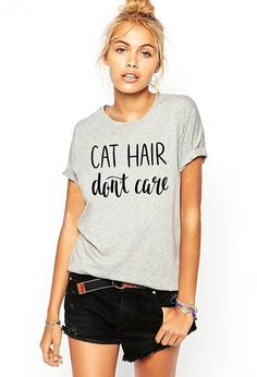 Got cat hair on your clothes and just don't care? Wear this cute Cat Hair Don't Care tee and tell the world that, yeah, you have a cat or two. Or 3 or 4.