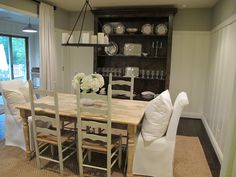 Jenny Steffens Hobick: Home | Stripping Furniture | Farmhouse Harvest Table | DIY Stripping Furniture Two end chairs with slip covers and pillow.