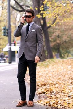 Light grey tweed jacket, white shirt, navy knit tie, navy pants