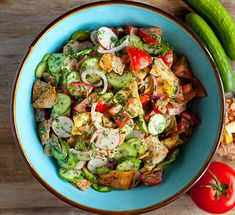 Fattoush Salad is a Middle Eastern salad that's made using day-old (or toasted) pitas, chopped vegetables, and fresh herbs.  The perfect summer salad!