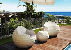"""Garde produces design objects inspired by the golf ball: outdoor and indoor furnishings as chairs, vases, tables, stools, lamps - in different sizes - characterized by """"dimples"""" of the balls. www.garde.it • info@garde.it"""