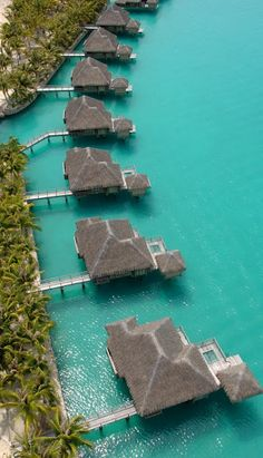 Bora Bora- So want to go here!! Tthe floors are glass so you can see the sea life under your feet, the CONDOS are further out than you can tell in this picture.