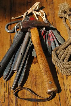 Antique Chouinard climbing pitons and hammer.Yvon Chouinard was an exceptional mountain climber and surfer who founded the outdoor apparel store,PATAGONIA.Commentary and re-pin by Steve ..... former Swiss Ski Guide in the Canton of Valais.