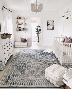 Boho gender neutral nursery farmhouse whitewalls whitedecor beadedchandelier vintagerug is part of Baby room decor - Deco Kids, Baby Nursery Neutral, Boho Nursery, Simple Baby Nursery, Baby Ideas For Nursery, Gender Neutral Nurseries, Nursery Room Ideas, Calming Nursery, Baby Bedroom Ideas Neutral