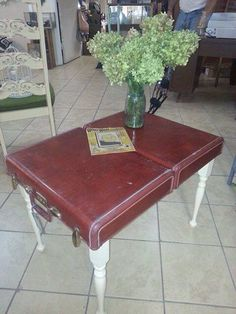 A suitcase repurposed into a table! Love!