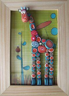 Cadre en bois avec girafe en pâte Fimo