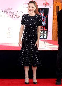 WInona Ryder in a black polka-dot midi dress