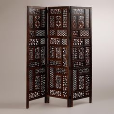 Crafted in India, our Carved Rena Screen showcases a vibrant patchwork design of traditional Indian motifs and designs. Each of the three connected panels feature 17 individual tiles for a beautiful patchwork design exclusive to World Market. With a rich dark brown finish, it provides enough privacy to be used as a room divider while still letting diffused light seep through, and is pretty enough to enjoy as decoration, too.