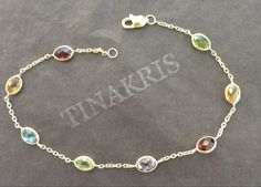 14k solid yellow gold and multicolor gemstones bracelet with yellow citrine, blue topaz, purple amethyst, green peridot and red garnet.