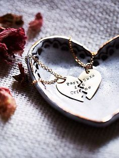 """Hand stamped in America, this friendship necklace features the fun phrase """"Partners in Crime."""" A perfect piece for you and your bff. Gold plated brass chain and adjustable lobster clasp closure.   *Lauren Elaine Designs   *Gold Plated Brass  *Made in the USA"""
