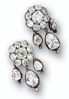 PAIR OF ANTIQUE DIAMOND PENDANT-EARRINGS, EARLY 19TH CENTURY  The floral cluster tops centering 2 cushion-shaped diamonds approx 2.10 and 1.90 carats respectively, framed by 16 smaller cushion-shaped diamonds weighing approx 5.30 carats, supporting 2 pear-shaped old-mine diamonds weighing approx 1.40 and 1.70 carats, flanked by 4 smaller pear-shaped diamonds weighing a total of approx 3.00 carats, accented further with 8 small old-mine and rose-cut diamonds, mounted in silver and gold.