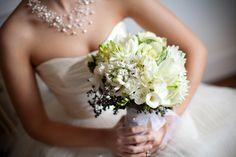 Bouquet of white cabbage, blue privet berry, white amarylis, white freesia, star of Bethlehem, and white fringed tulips.