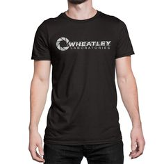"""""""I AM NOT A MORON."""" - Wheatley: personality core; moron. Printed on 100% cotton; pre-shrunk, basic tee. Garment color is Black, wash cold, dry on low heat or air dry."""