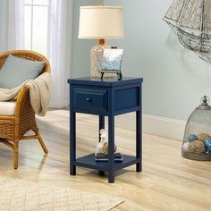 The Sauder Woodworking Cottage Road Side Table adds country charm to your living spaces. This side tables features a single drawer and a classic bottom shelf for extra storage and display space. Choose from the available finishes to complement your décor. Table Furniture, Living Room Furniture, Furniture Sets, Furniture Design, Sauder Woodworking, Table Top Display, End Tables With Storage, Wooden Tops, Open Shelving