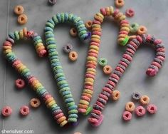 Fruit Loop candy canes...great kid craft+fine motor skill for small ones.