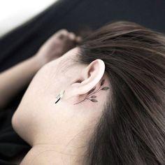 Small plant behind the left ear. Tattoo artist: Hongdam