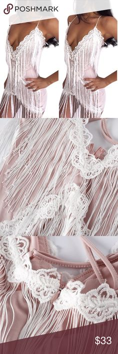 NWT Pink Fringe White Lace Plunge Dress Bodycon S NWT size S Plunge Dress in light blush pink with white lace trim and fringe. Bodycon fit with adjustable straps. Show stopping piece. Stretchy, true to size. Brand unknown.   Tags: low neckline Sexy Miami Las Vegas Khloé Kardashian style lace party club oh Polly fashion nova style caster free people dress small NWT new Kylie Jenner top shop missguided plt pretty little things Topshop Dresses Mini