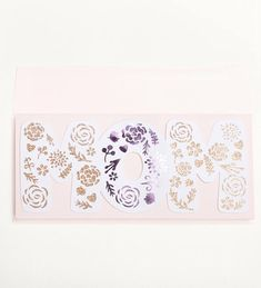 Lavishly designed, this floral cut card was inspired by those outdoor mothers day tea parties. The light pink card stock, caramel glitter and purple foil reminds us of baking tables layered with lavender tablecloths and covered buttercream filled macaroons.  Features:  - Backed on
