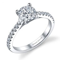 Modern diamond engagement ring adorned with fine Round diamonds of G-VS2 quality, French pave set half way around the band half way. Delicate sparkle.