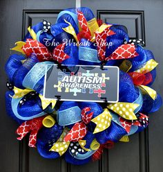 Show your support for Autism Awareness with this blue deco mesh wreath, accented with black and turquoise mesh ribbons, red and yellow mesh spirals, and assorted coordinating ribbons. It is finished off with an Autism Awareness aluminum all-weather novelty license plate sign featuring the puzzle piece symbols. This wreath measures about 26 across and is Made to order.  Please check my other listings for more designs or contact me with your custom request. Centerpiece decorations can always…
